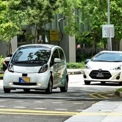 self-driving car and standard car on the street