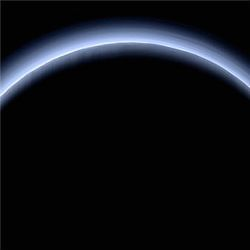Pluto illuminated from behind by the sun