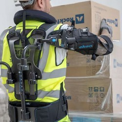 worker wearing EksoVest lifting a box