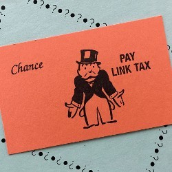 Monopoly Chance card stating Pay Link Tax