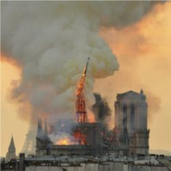 Notre Dame spire fire