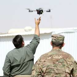 Instructors at the ARCENT Readiness Training Center in Kuwait demonstrate how to launch an aerial drone.