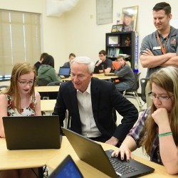 Arkansas Gov. Asa Hutchinson with computer science students