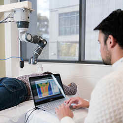 A collaborative robot applies targeted laser therapy to pain hot spots' identified by a thermal camera.