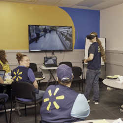 A Walmart employee goes through training in virtual reality.