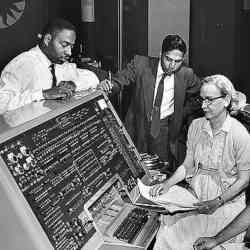 From left, programmers Donald Cropper, K.C. Krishnan, and Grace Hopper at the console of Univac I. Not shown: Norman Rothberg.
