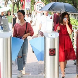 students at facial recognition turnstile at China Pharmaceutical University