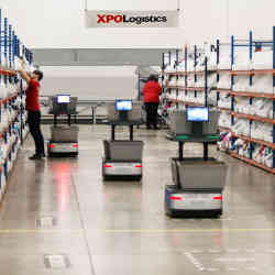 Robots work alongside people at an XPO Logistics facility.