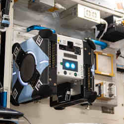 The Astrobee cube robot  Bumble in its docking station onboard the International Space Station