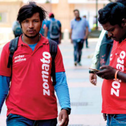individuals wearing shirts of Indian restaurant aggregator Zomato