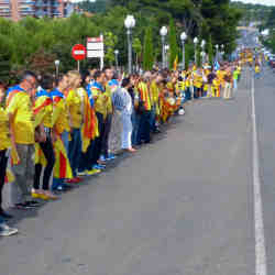 The September 2013 Catalan Way, in which 1.2 million people  many clad in yellow shirts and blue scarves  linked arms to support Catalan independence from Spain