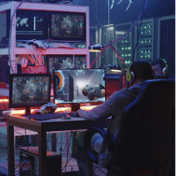 hackers and many screens in dark room, illustrative photo