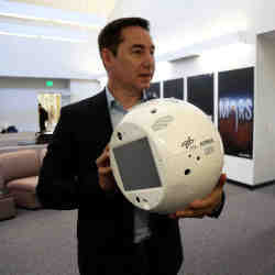 IBM's Bret Greenstein holds a clone of the artificial intelligence bot named CIMON.
