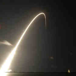 A SpaceX rocket carrying 60 satellites lifts off.