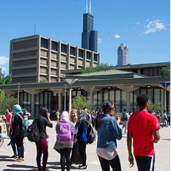 students on UIC campus with Willis Tower in background