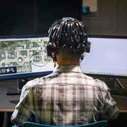 A gamer connected to electroencephalogram technology.