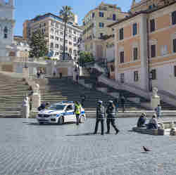 A police car sits at the bottom of Rome's Spanish Steps.