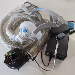 low-cost Powered Air Purifying Respirator with filter adapter and mask