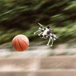 The quadcopter dodges the basketball.