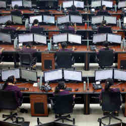 Employees wear protective masks inside a call center run by Uttar Pradesh state police.