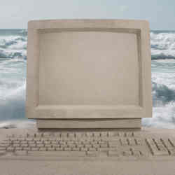 A PC made of sand awaits the next big wave.