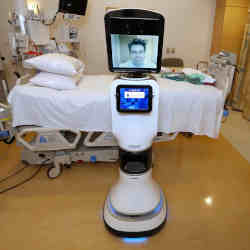 Mercy Telehealth Network medical director Dr. Alan Shatzel using the telepresence RP-VITA robot at Mercy San Juan Hospital in Carmichael, CA.
