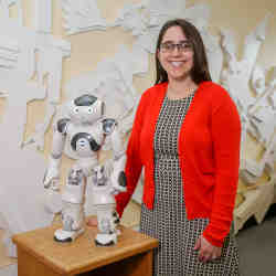 Oregon State University's Naomi Fitter, with the robot comedian.