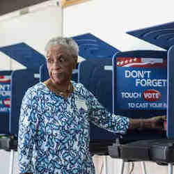 A woman uses a voting machine during the South Carolina Democratic primary in 2016.