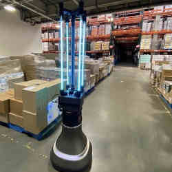 The robot disinfects a stockroom.