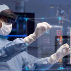 A doctor using HoloLens 2 Augmented Reality in the operating room.