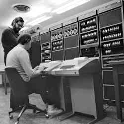 Dennis Ritchie, standing next to a seated Ken Thompson, in this 1973 photo.