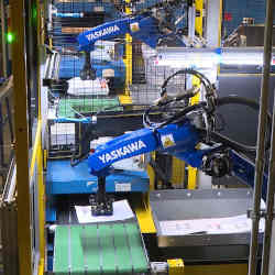 Robotic arms sort packages at the FedEx Express World Hub in Memphis, TN.