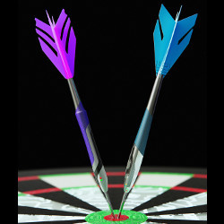 two darts in dartboard bullseye