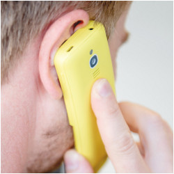 man holding mobile phone to ear