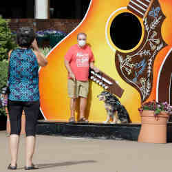 Tourists snap a photo in Nashville, TN, a city using artificial intelligence software to track short-term vacation rentals.