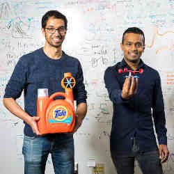 Two members of the University of Washington team show off some 3D-printed Internet of Plastic Things things.