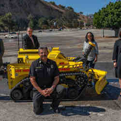 Members of the Los Angeles Fire Department with their new robot.