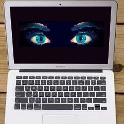 laptop computer with watching eyes