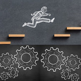 worker leaps over cogs and gears
