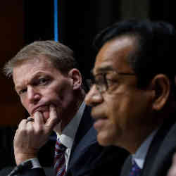 Kevin Mandia of FireEye and Sudhakar Ramakrishna of SolarWinds at an intelligence hearing Tuesday.