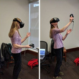 student in VR goggles holding VR wants