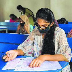 female student in classroom in India
