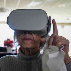 A nursing-home resident in Falls Church, VA, experiences virtual-reality nature scenes.