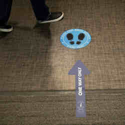 Social distancing signs have been placed on the floor at Cushman & Wakefields offices in Chicago.