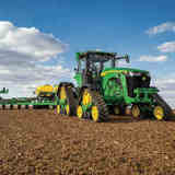 A John Deere 8RX connected tractor at work.