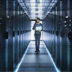 An IT worker in a data center.